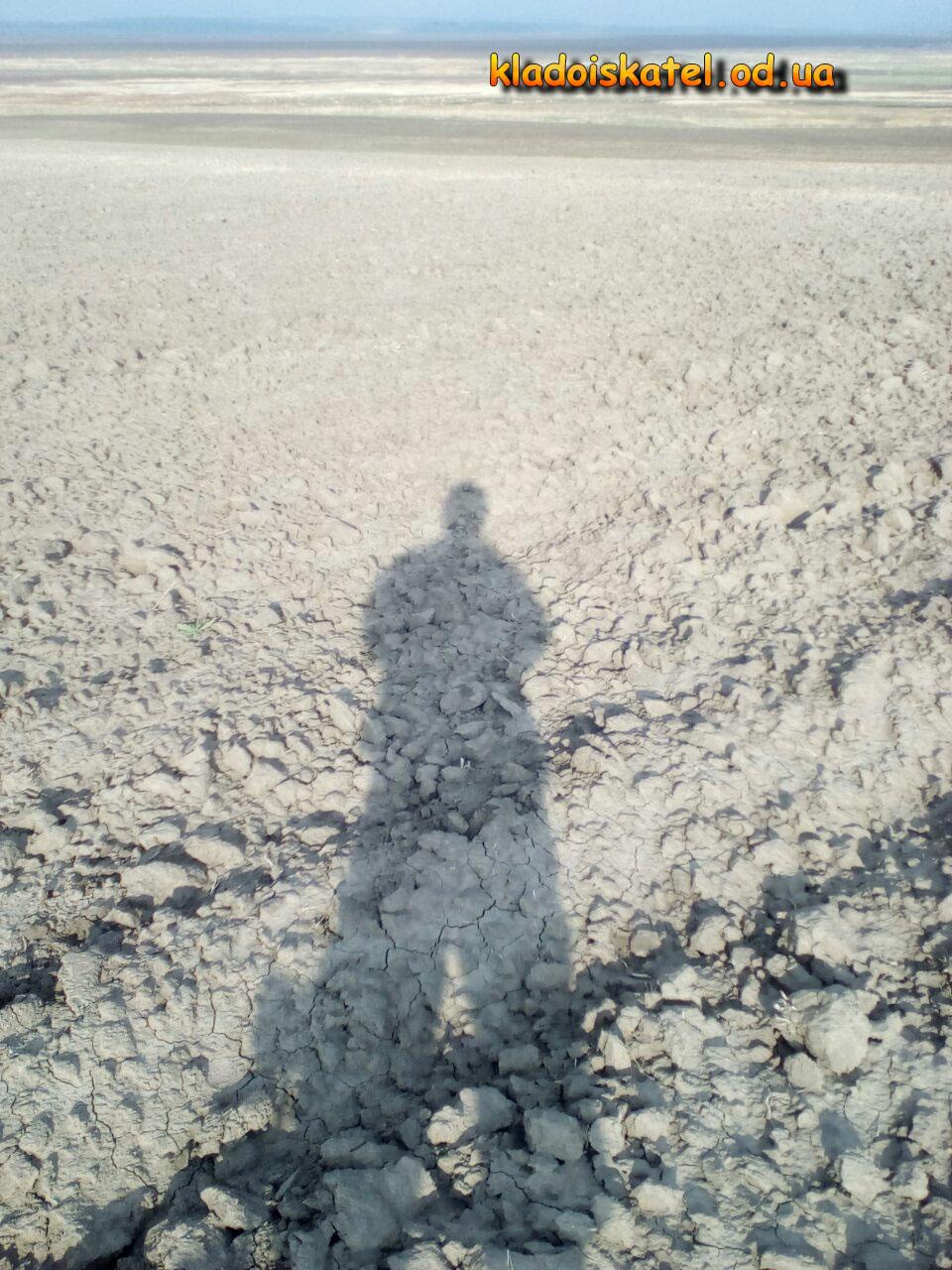 тень копателя